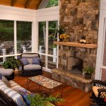 fireplace and furniture in porch